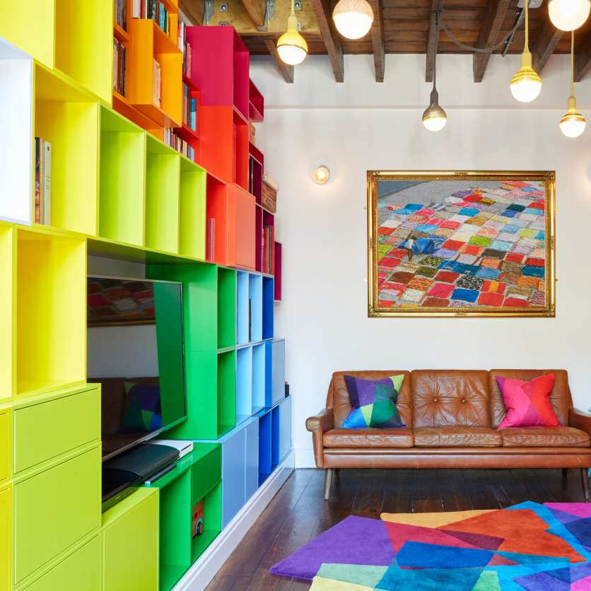 Colourful floor-standing shelving combination with TV