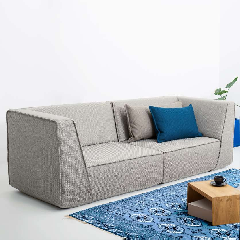 Light grey sofa with grey and blue cushions