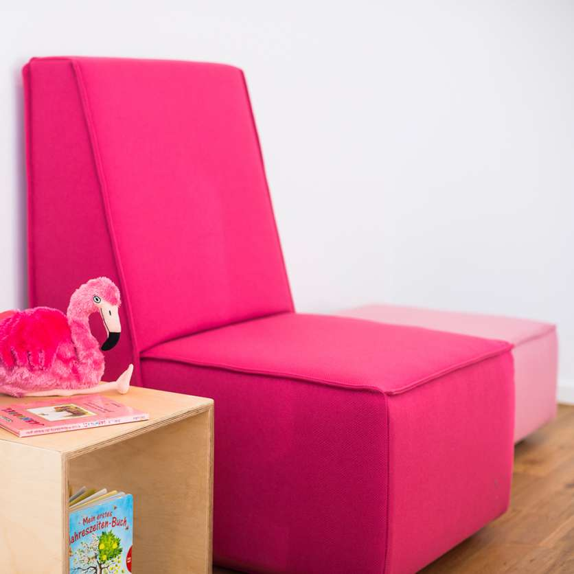 Pink sofa with pink ottoman
