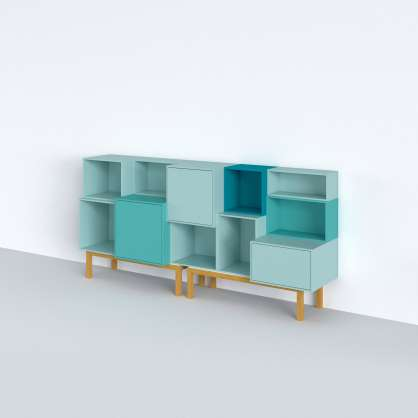 Lots of shelving modules forming a modular sideboard in blue