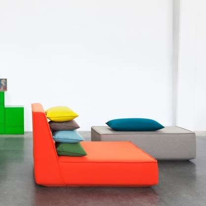 Red armchair with ottoman and colourful cushions