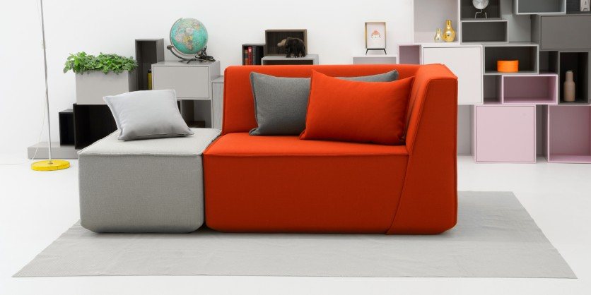 Free-standing sofa with ottoman orange and grey