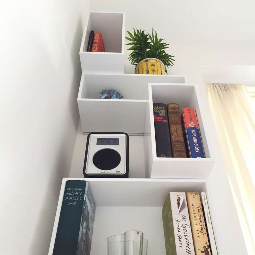 White alcove shelving with speakers