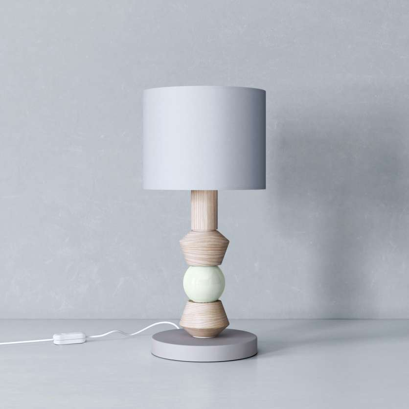 Bedside lamp with mint-coloured detail