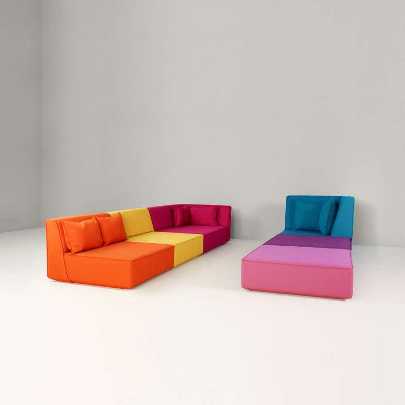 Two expressive sofas combined to form a duet
