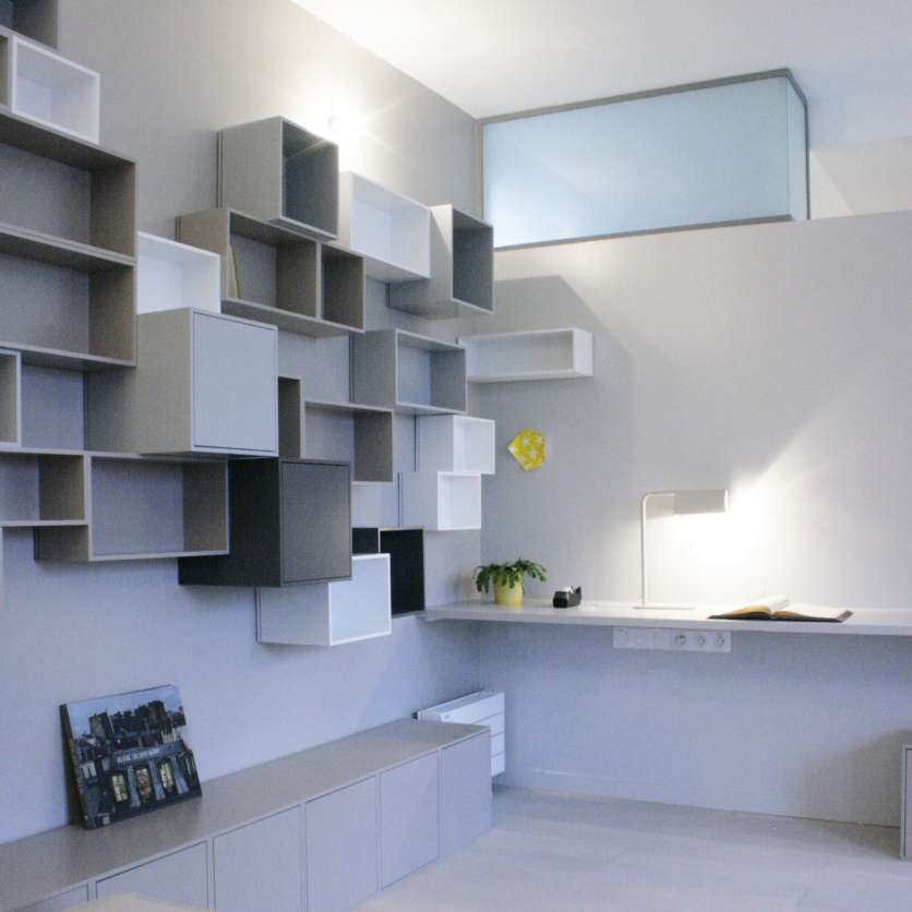 Wall-mounted book shelving in grey and white
