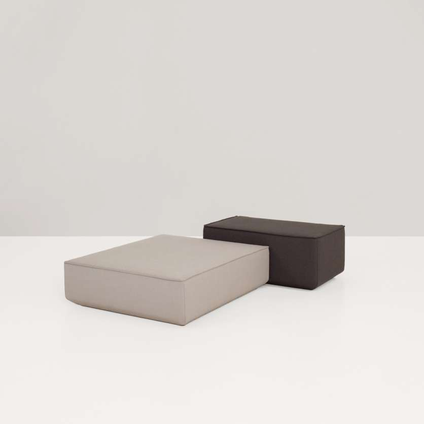 Two ottomans forming a strong design-duett