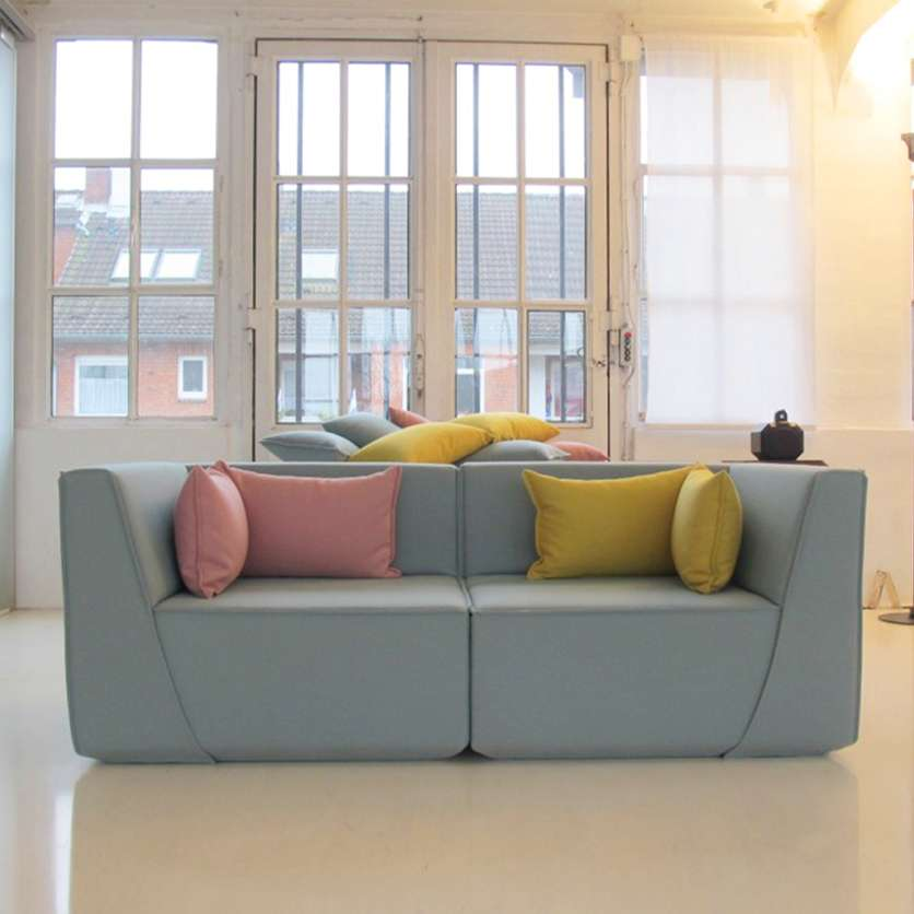Light blue 2-seater sofa with colourful cushions