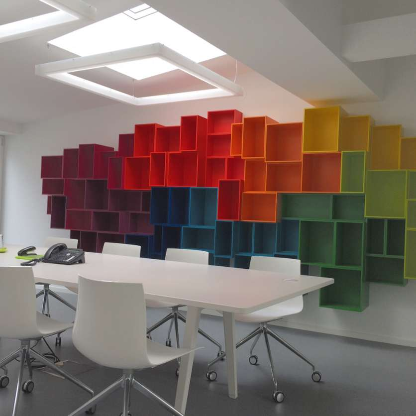 Colourful wall-mounted office shelving