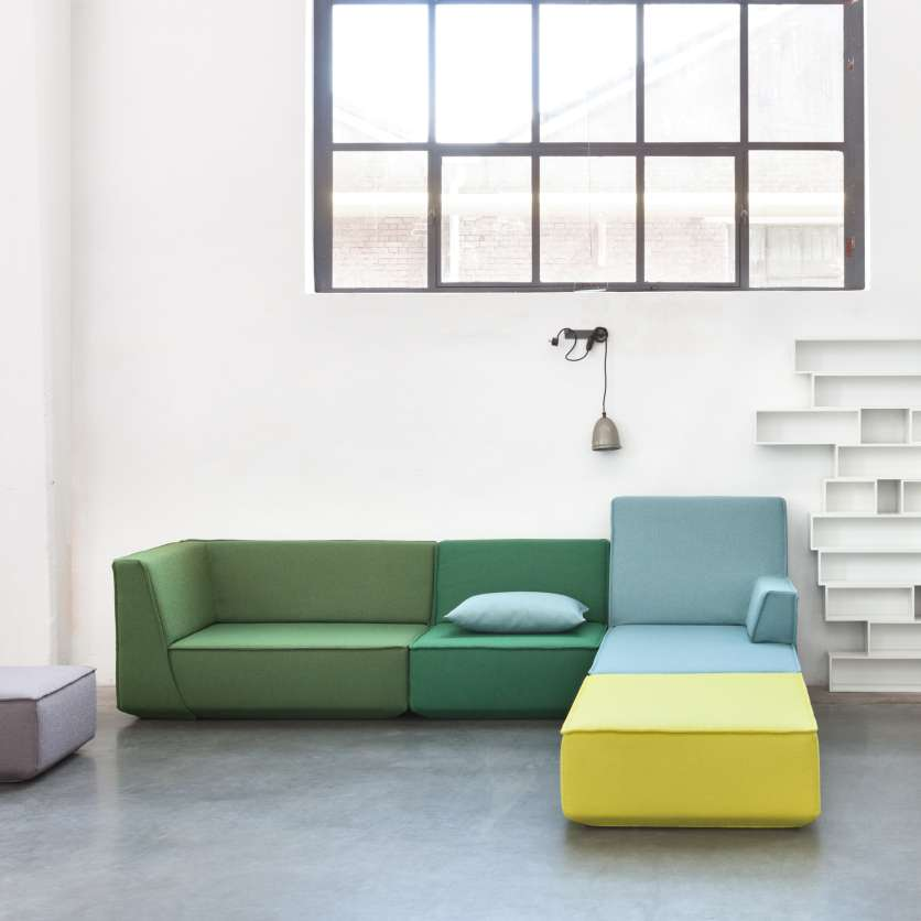 Sofa and chaise longue with yellow, blue, and green fabrics