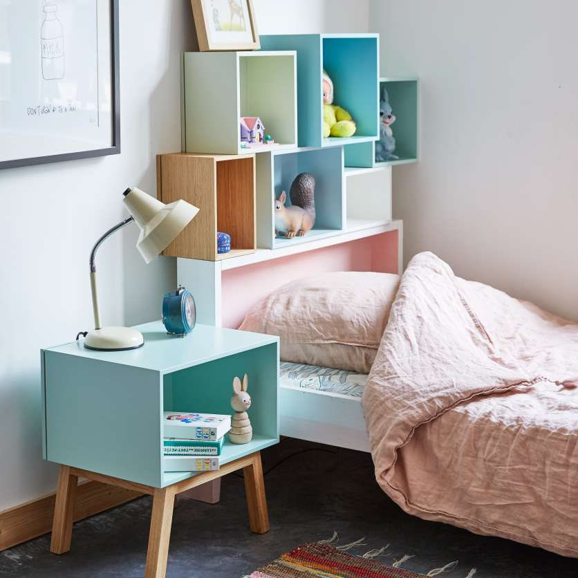 Pastel-coloured bedside table and lamp