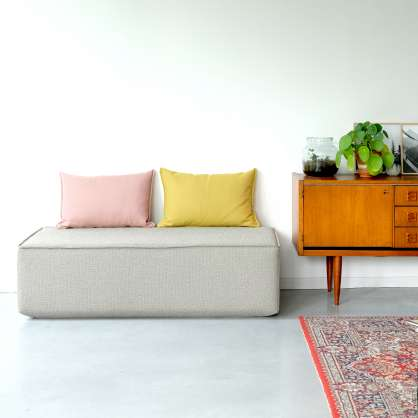 Grey ottoman with 2 cushions