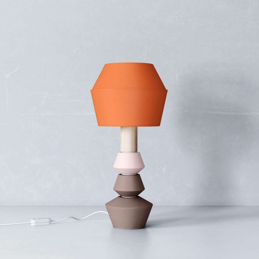 Modular table lamp with orange-coloured lampshade