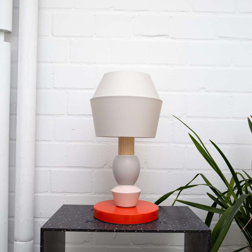 White and grey modular table lamp with red stand