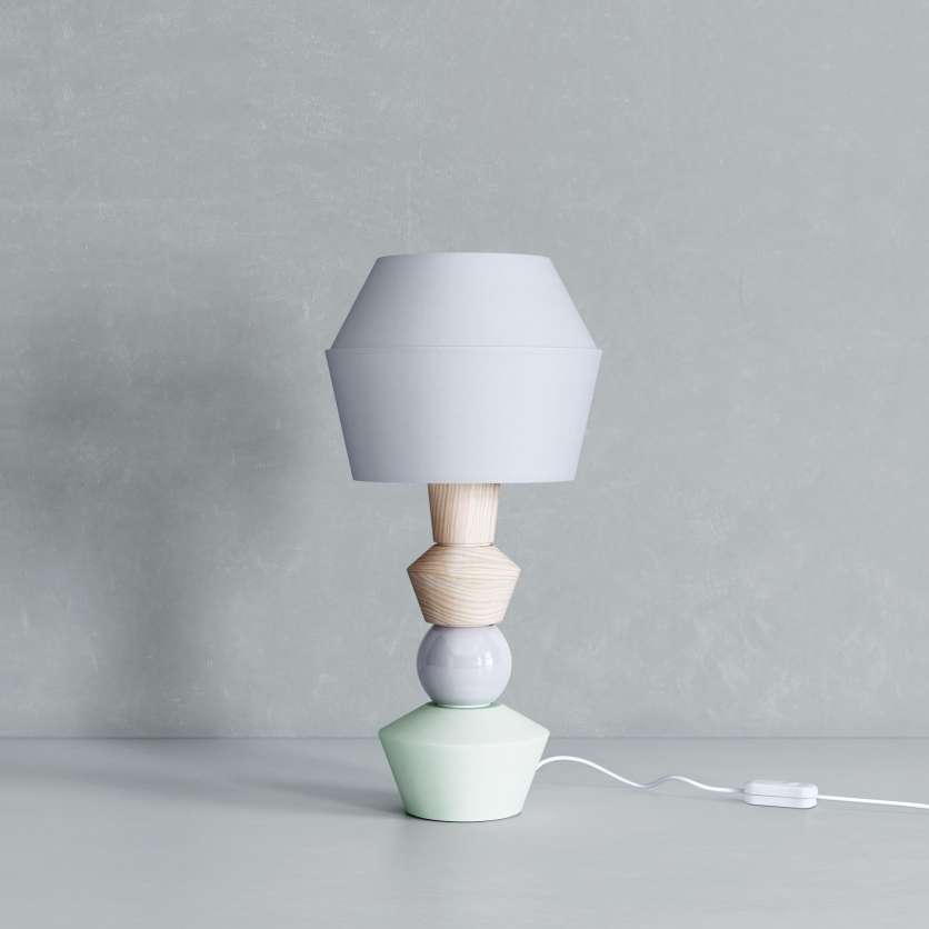 Modular table lamp in pale shades.