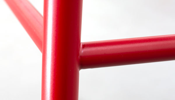 Powder-coated chair legs in red