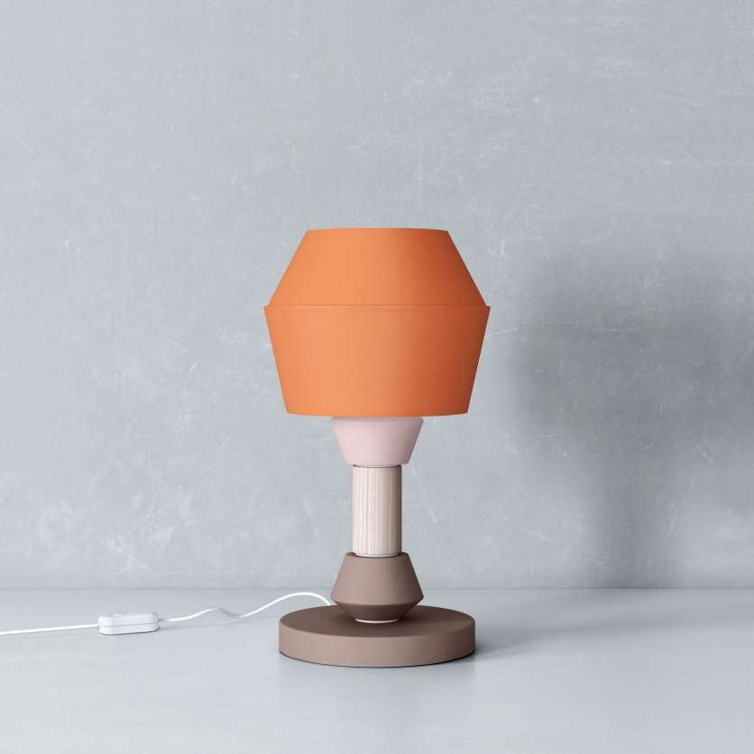 Table lamp with orange conical lampshade