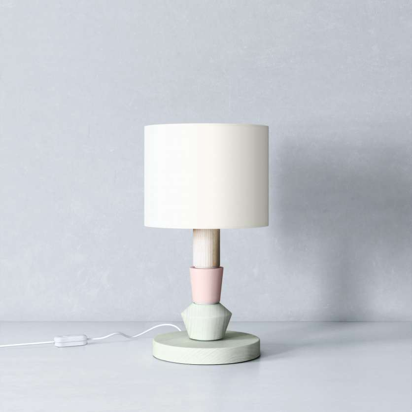 Bedside lamp with green stand and cream-coloured lampshade
