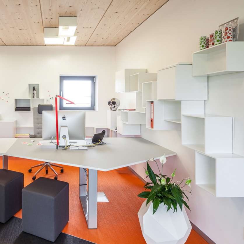 Wall-mounted office shelving in white