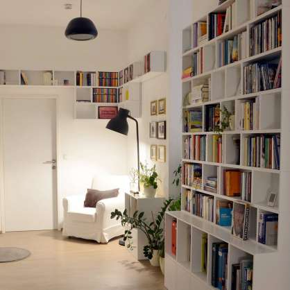 Uses the space: white book shelving for the living room