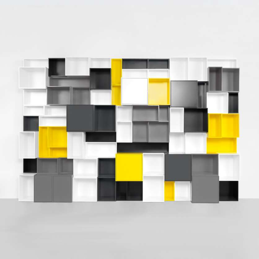 Book shelving in white, grey, black, and yellow