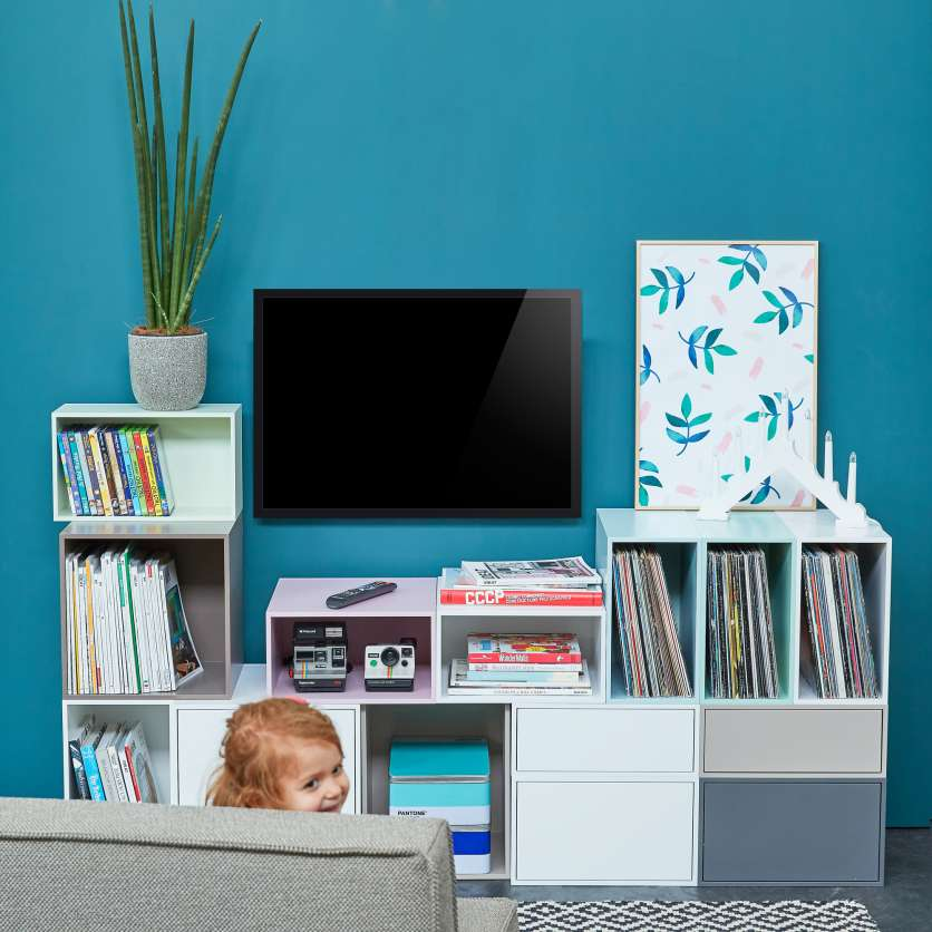 Modern, modular floor-standing shelving combination with TV