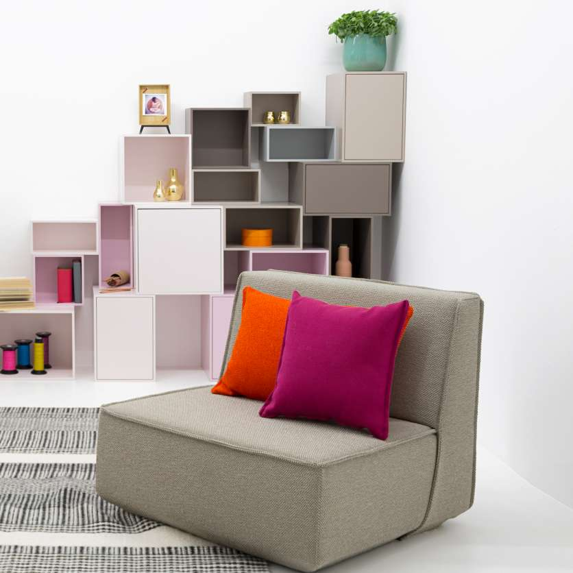 Soloist: grey sofa with orange and pink cushions