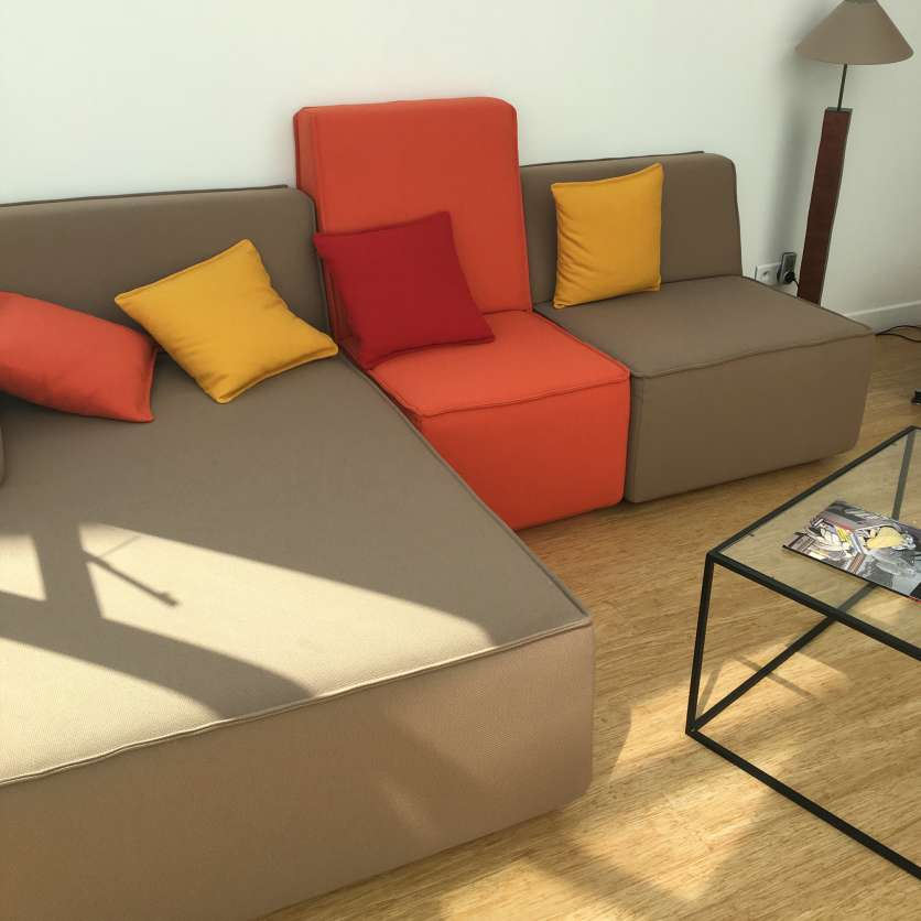 Sofa ensemble with colourful cushions