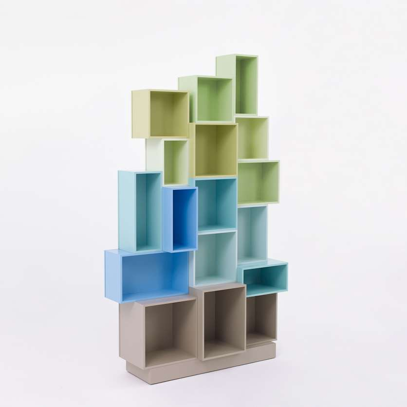 Modern design shelving system composed of blue-green shelving modules