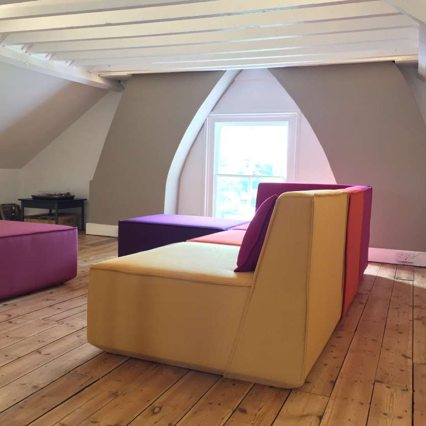 Great attic with sofa ensemble of yellow, orange and purple modules