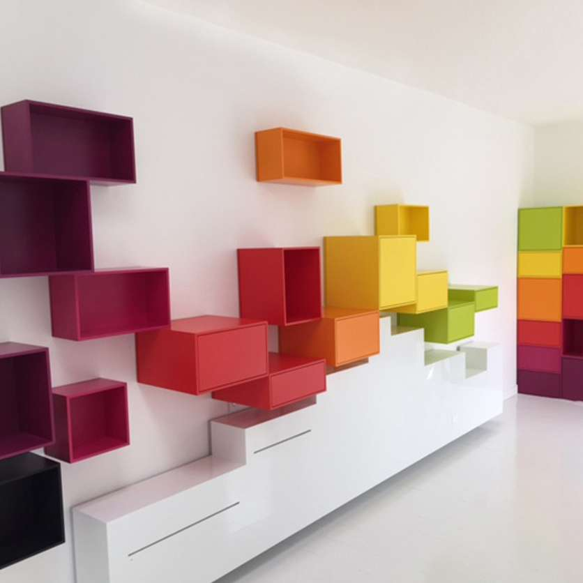 Colourful wall-mounted shelving modules