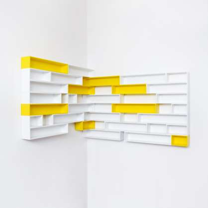 Corner shelving for CDs in yellow and white