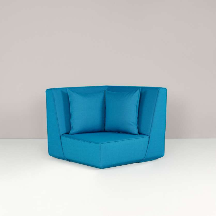 A corner armchair with a high backrest