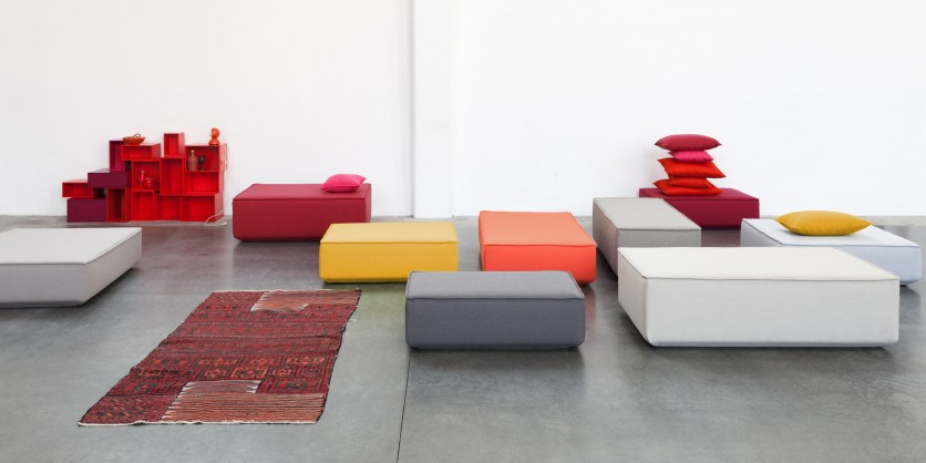 Minimalist sofa ensemble with carpet and shelving